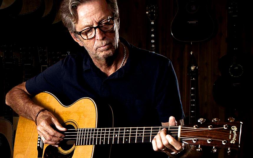 http://maquinasdemusica.com/wp-content/uploads/2013/06/Eric-Clapton-e-o-seu-Martin.jpg